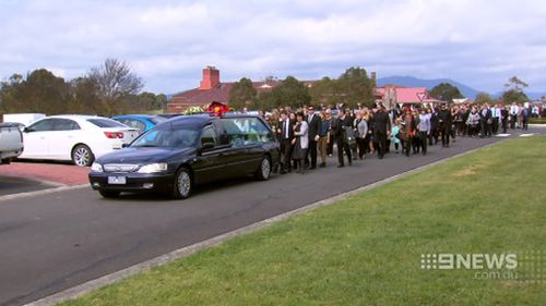 Hundreds of friends and family followed the casket after the service. (9NEWS)