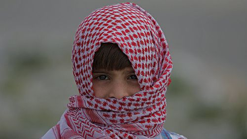 A Palestinian refugee boy attends a protest commemorating Land Day along the border between Israel and Gaza Strip. (EPA)