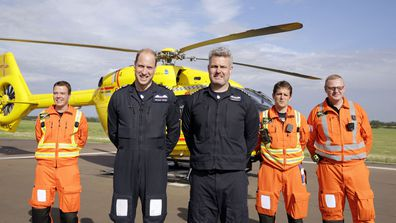 Britain's Prince William, the Duke of Cambridge, second left smiles, as he poses for a photo with colleagues before starting his final shift with the East Anglian Air Ambulance based out of Marshall Airport, near Cambridge, England, Thursday, July 27, 2017
