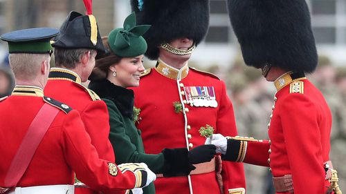 The Duchess of Cambridge presents shamrock to officers and guardsmen of 1st Battalion the Irish Guards. (PAA/AAP)