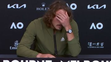 Stefanos Tsitsipas casts a downtrodden figure after crashing out of the Australian Open. (Nine)