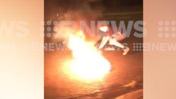 Man rolls in fire on Cracker Night in Darwin
