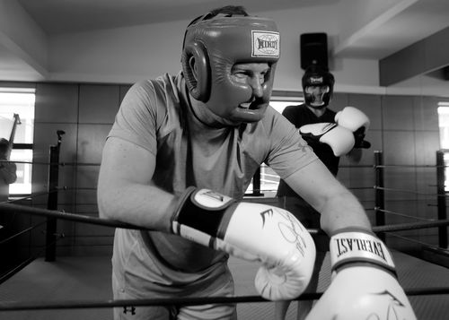 A Current Affair's Steven Marshall in the ring with Bachelorette star Stu Laundy.