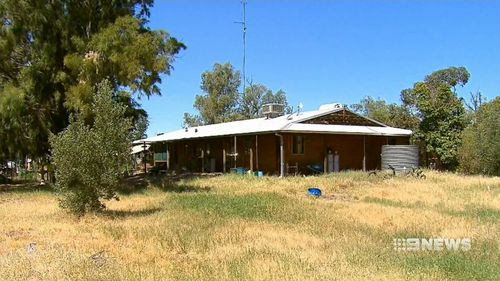 The woman's body was found inside the property. (9NEWS)