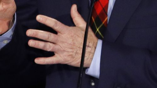 The Jerusalem Cross can be seen on Tom Steyer's hand.