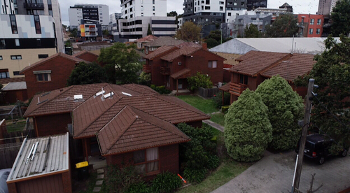 Home owners join forces to turn modest brick villas into gold mine