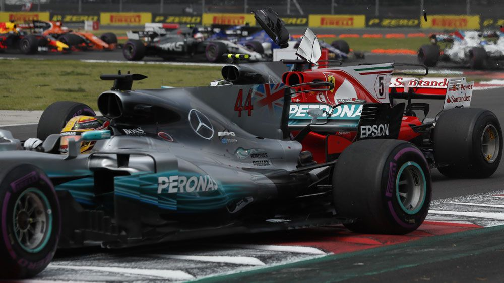 Lewis Hamilton and Sebastian Vettel collide in dramatic start to Mexican F1 Grand Prix
