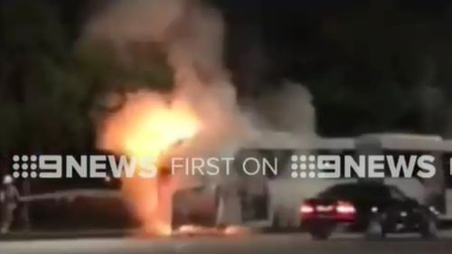 The bus became engulfed in flames just after 7pm yesterday. (9NEWS)