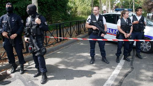 A man was shot dead by police after a knife attack in a suburb west of Paris.