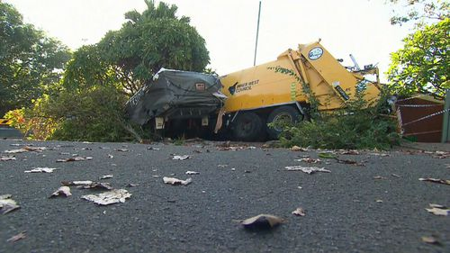 The garbage truck hit a caravan, boat and a car before smashing into the house. (9NEWS)