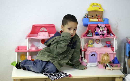 Jensen Torres, 4, waits for his family at the Catholic Charities RGV in Texas.