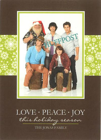 The Jonas Brothers posed with <strike>a scary hobo</strike> their dad(?) for this family greeting card.