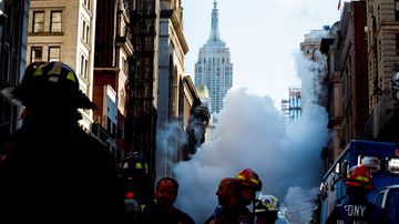 A large cloud rises from a steam explosion in Manhattan, New York City. (AAP)