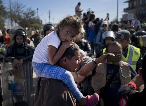 Men, women and children were all hit by the highly potent teargas as US Border Guards prevented them from going any further.