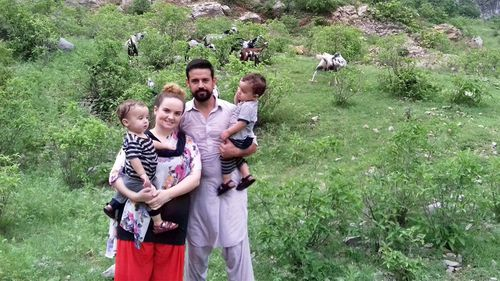 Ms Burgess and her husband Mr Wangkimshen, pictured in Pakistan, where the family was living until earlier this year.