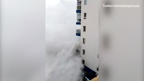 The waves took out a third-floor balcony.