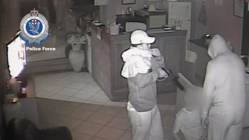 The men assaulted, threatened and robbed employees at two businesses in Villawood and Ingleburn. Picture: Supplied.