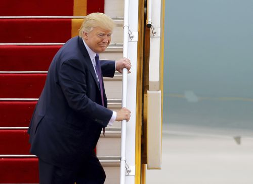 Trump makes a comment as he boards Air Force One in Asia.