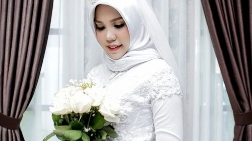Indonesian woman Intan Syari poses in her wedding dress on what was intended to be the day she married Dr Rio Nanda Pratama, who died in the Lion Air tragedy in Jakarta.