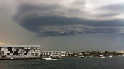 The boat tries to outrun the rain in Balmain East. (Milanda Rout)
