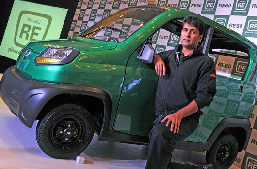 Bajaj Auto managing director Rajiv Bajaj poses with the RE60 in New Delhi. (Getty)