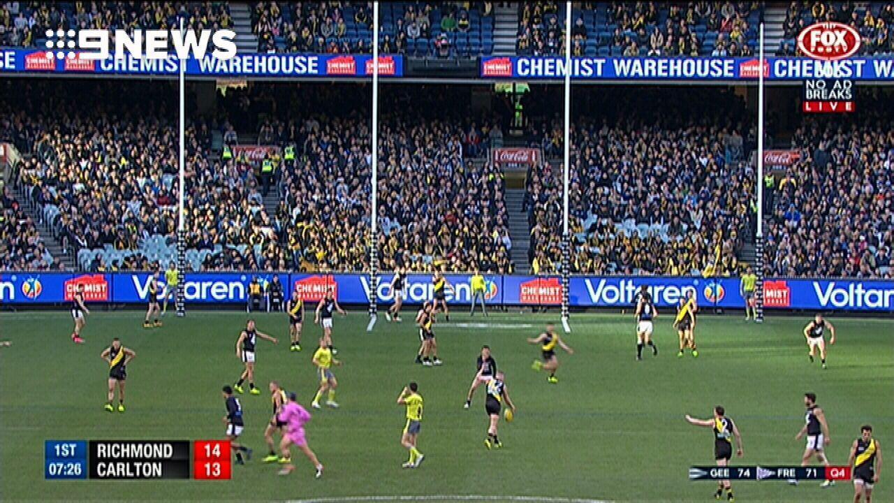 Caddy duffs a kick against Carlton