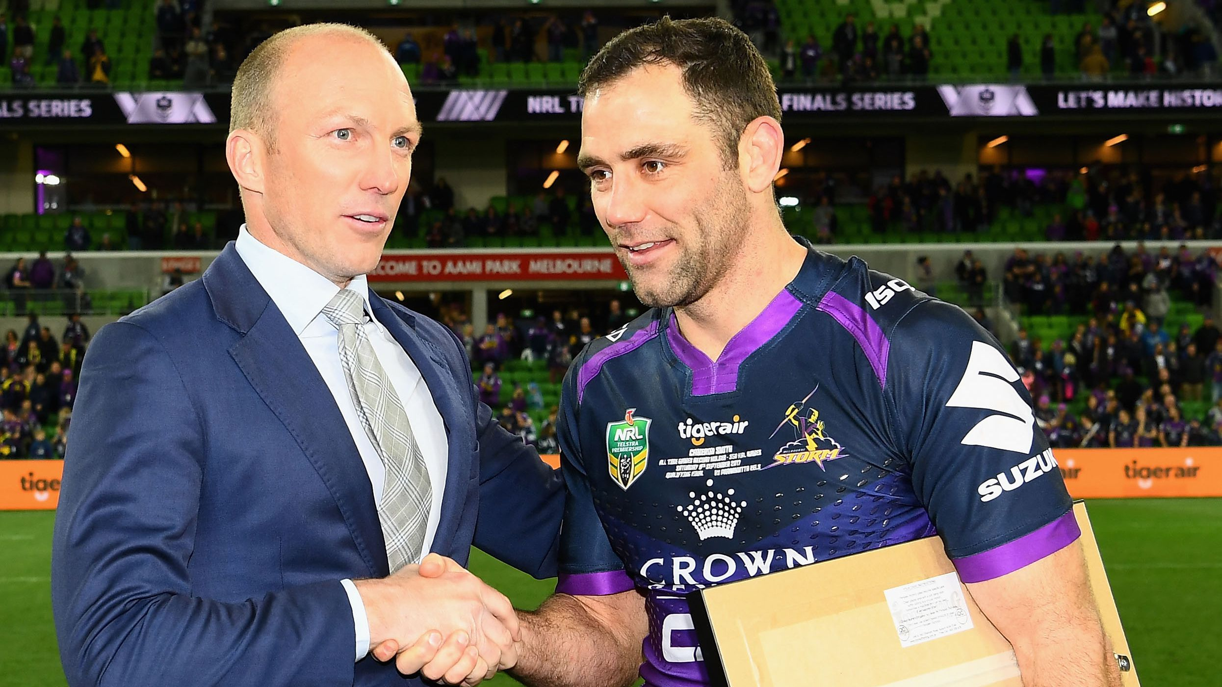 Darren Lockyer congratulates Cameron Smith on a milestone.