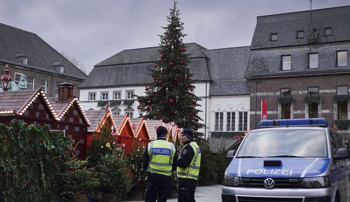 Police officers watch the Christmas Market in Duesseldorf,