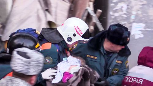 Rescuers heard crying and were able to reach the infant, despite temperatures being as low as -22C.  They spotted his leg and a pink sock.