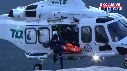 Issac suffered multiple broken bones and was winched to safety by a rescue helicopter after falling off a cliff edge in the NSW Blue Mountains.