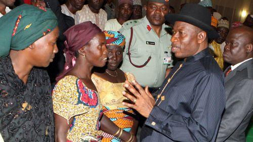 Nigerian president meets relatives of hostage schoolgirls, 100 days since their capture
