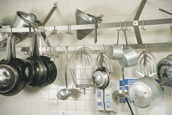 Hang the pans you use the most on a stainless steel rail near your stove (Thinkstock)