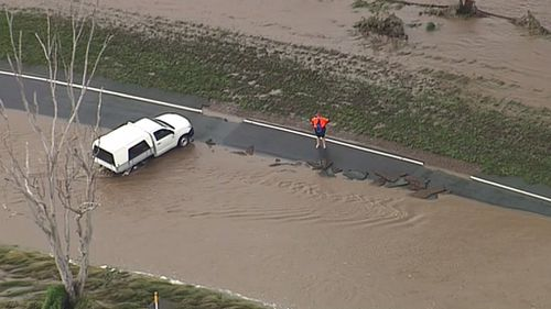 A car appears to be stuck in floodwaters at Laravale. (9NEWS)