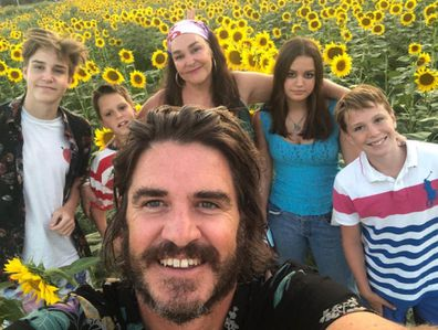 Kate Langbroek and her family in a field of sunflowers in Italy