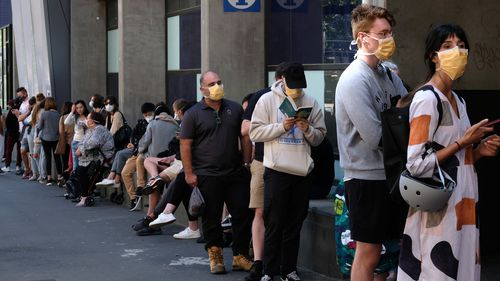 People are seen lining up to get tested for Coronavirus at the Royal Melbourne Hospital  on Tuesday 10 March 2020.