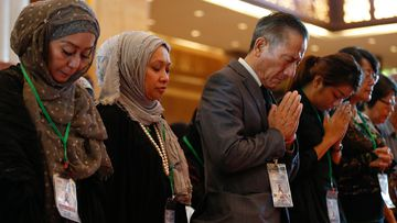 A memorial service was held at Kuala Lumpur International Airport ahead of the one-year anniversary of MH17. (AAP)