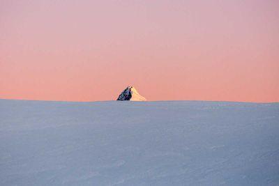 """<strong>Mount Aspiring (<em>Tititea'</em> in Māori) by <a href=""""http://www.markclintonphoto.com/"""">Mark Clinton</a></strong>"""
