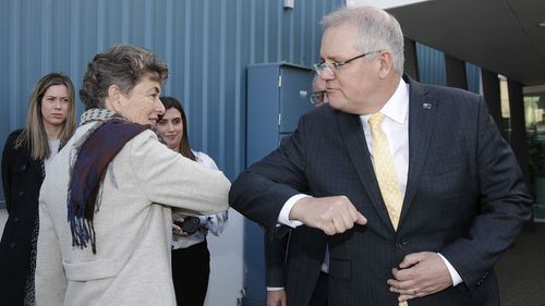 Scott Morrison bumps elbows with Liberal candidate Fiona Kotvojs.