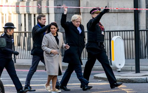 British Prime Minister Boris Johnson with Home Secretary, Priti Patel, visits the crime scene with City of London Police Commissioner Ian Dyson and Commissioner Cressida Dick near London Bridge in London.
