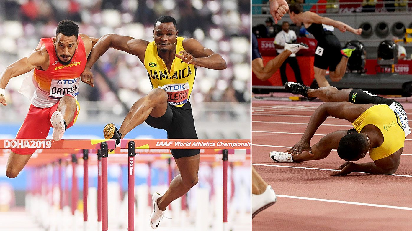 Omar McLeod of Jamaica falls in the Men's 110 metres hurdles final