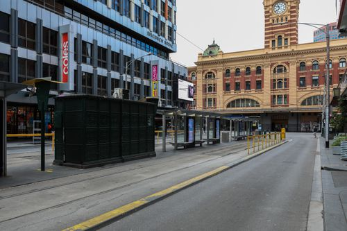 MELBOURNE, AUSTRALIA - SEPTEMBER 18: A deserted Elizabeth Street tram stop near Flinders Street station on September 18, 2021 in Melbourne, Australia. Anti-lockdown protests have been planned in Melbourne despite current COVID-19 restrictions prohibiting large outdoor gatherings. Victoria police are shutting down the public transport network in the CBD in a bid to discourage protestors. Metropolitan Melbourne is currently subject to lockdown restrictions as health authorities work to contain the