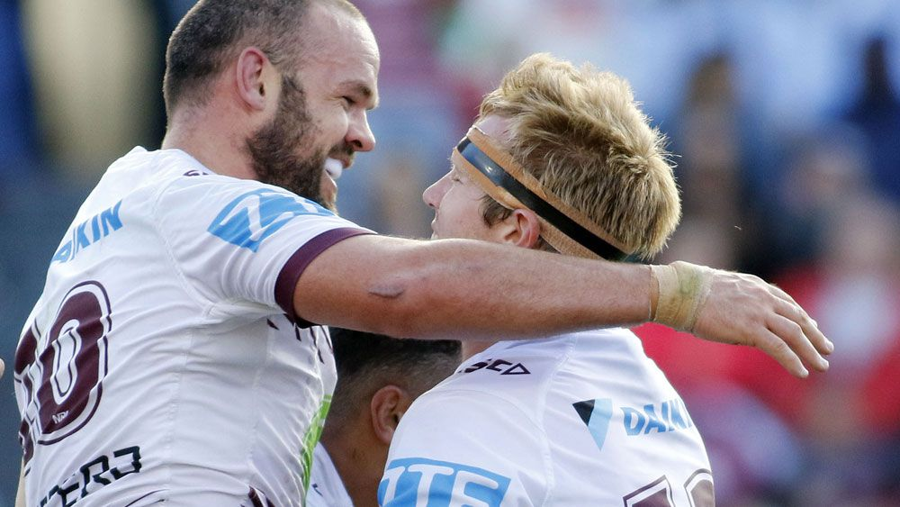 State of Origin rivals Nate Myles and Jake Trbojevic together for Manly. (AAP)