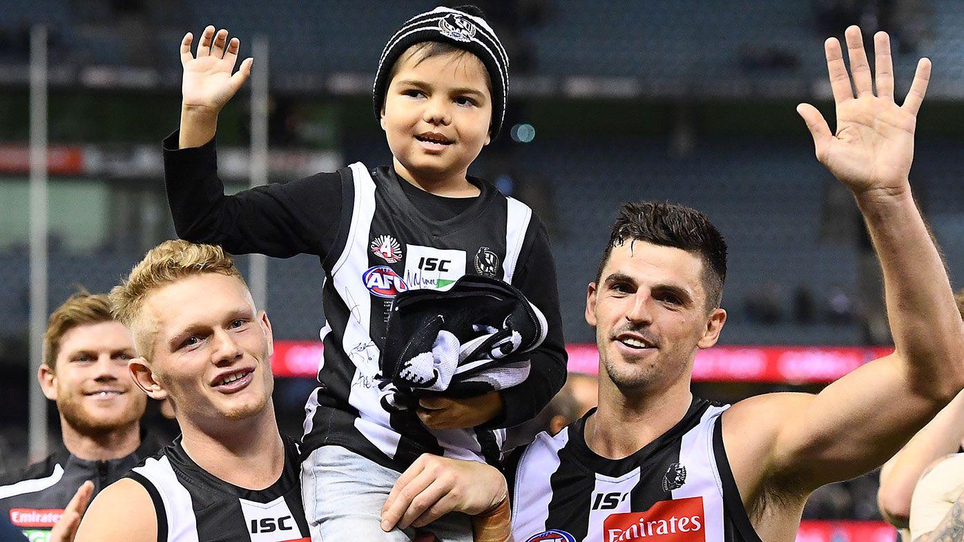 'It breaks your heart': Collingwood star Adam Treloar dedicates win to cancer-stricken young fan