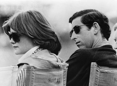 Prince Charles and Lady Sarah Spencer, the elder sister of Diana, watch a polo match at Windsor.