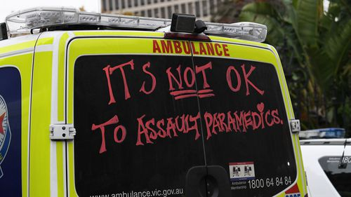 A man has died after a group of people interfered with paramedics.