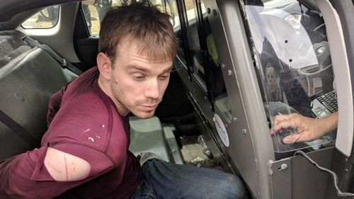 Travis Reinking was arrested after a 24-hour manhunt. (AP/AAP)