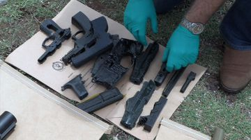 Several firearms were seized from the Charlestown home in Lake Macquarie.