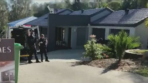 Heavily armed police remain in the area. (9NEWS)