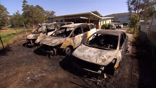 Burnt-out cars on the NSW mid-north coast.