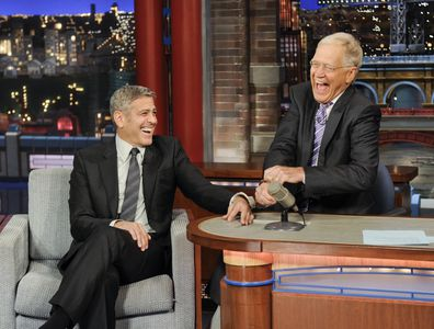 George Clooney handcuffs himself to Dave in an attempt to keep Dave from leaving the show, on the Late Show with David Letterman, Thursday May 14, 2015 on the CBS Television Network.